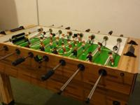 An Imperial Foosball table with user's manual. Model is