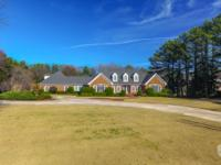 Sprawling brick ranch on this beautiful property