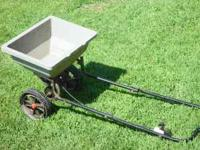 seed/fertilizer spreader..... made for pulling behind