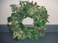 Spring/ summer door or wall wreath. Nice silk leaves.