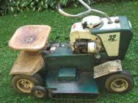 1950's riding lawn mower, runs and cuts great with