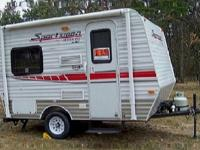 The Sportsmen Sportster toy hauler travel trailer by KZ