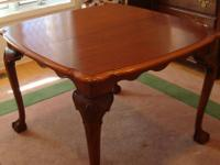 This is a 42 inch square maple dining table made by