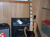 Like New Squier Bass by Fender. This guitar has a