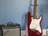 Red Fender Guitar, with 6 brand new strings and a new