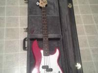 Used Squier P Bass with hard travel case and small amp.
