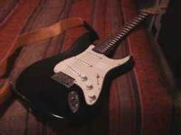 up for sale is a 2000 model squier stratocaster.. it