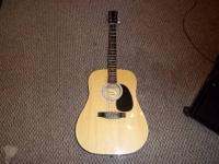 Dreadnought body that includes a laminated spruce top,
