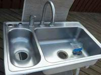 SS Sink is good quality. Top mount and well insulated.