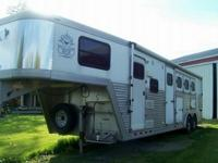 The trailer has a full side awning, dual batteries and