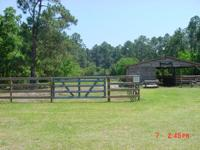 2 1/2 acres pasture,4 stables,covered feed and tack