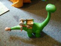 Dinosaur, puppy pull toy, bucket of train tracks,