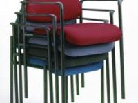 New in box stackable chairs in four different colors.