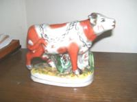 Very nice Staffordshire cow figurine. No chips or