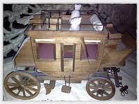 Wooden stagecoach model. Dimensions: 14 1/2 inches x 9