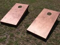 Stained corn hole boards with set legs. Consisted of