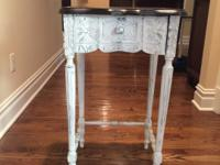 Stained wood top, distressed shabby chic legs.  Cabinet