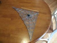 This is a real leaded glass spider web with spider