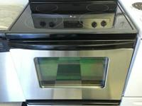 "Used Whirlpool 30"" stainless steel, glasstop stove and"