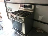 We have a very gently used Electrolux Gas Range (double
