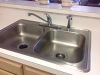 Stainless double kitchen sink and faucet. Excellent .