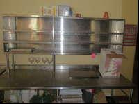 Heres a two tier stainless-steel prep table, it come