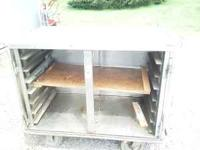 For sale is a stainless steel rolling cart. It roughly