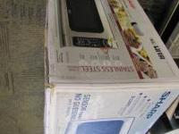 SHARP 1200W STAINLESS STEEL MICROWAVE. STILL IN BOX-
