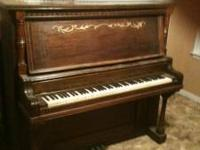 old upright piano . all keys and pedals still work ...