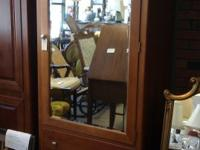 Here we have a solid wood stanley furniture mirrored