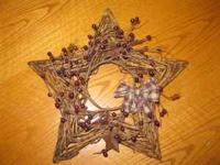 This star is made of branches and has a metal frame. It