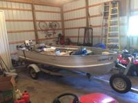 14ft starcraft deep v fishing boat. Comes with