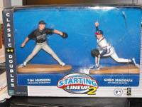 Vintage sports action figures. Greg Maddox and Tim