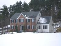 This stately brick front colonial set back from