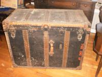 Selling a huge old Steamer Trunk. When standing on it's