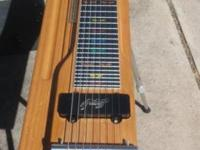 Remington 8 String Steel Guitar on stand with 4 legs.