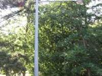 Lg steel street light pole w/light 20 -30' high. Could