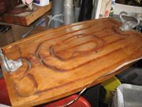 For sale is this large wooden meat carving board with a