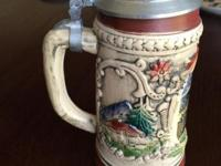 The smaller stein is Hand Painted and is $45.00, the