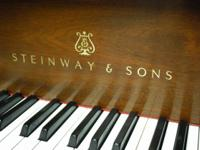 "1992 Steinway model M 5'7"" grand piano Sold with 5 year"