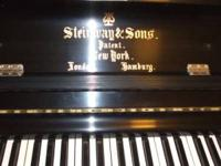 TWO STEINWAY UPRIGHTS GIVING THE PAIR AWAY FOR $3800