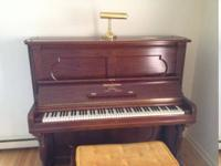 Includes piano bench and brass piano light.