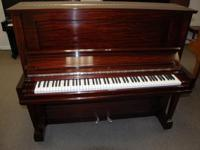 Here is a classic. This is a lovely Steinway K upright