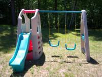 This Naturally Playful Playhouse Climber & Swing
