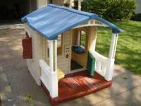 This is the Naturally Playfull Front Porch Playhouse.