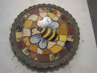 "Set of 3 stepping stones with bumblebee. 11"" x 11""."