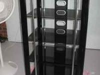 Beautiful stereo cabinet - dark-tinted glass and shiny