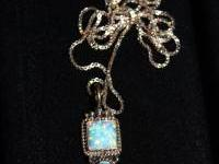 Very pretty necklace, opal really sparkles, stamped on