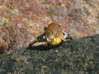 This is a very nice Citrine solitare. Ring is a size 6,