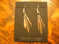 These feather earrings are sterling silver and have
